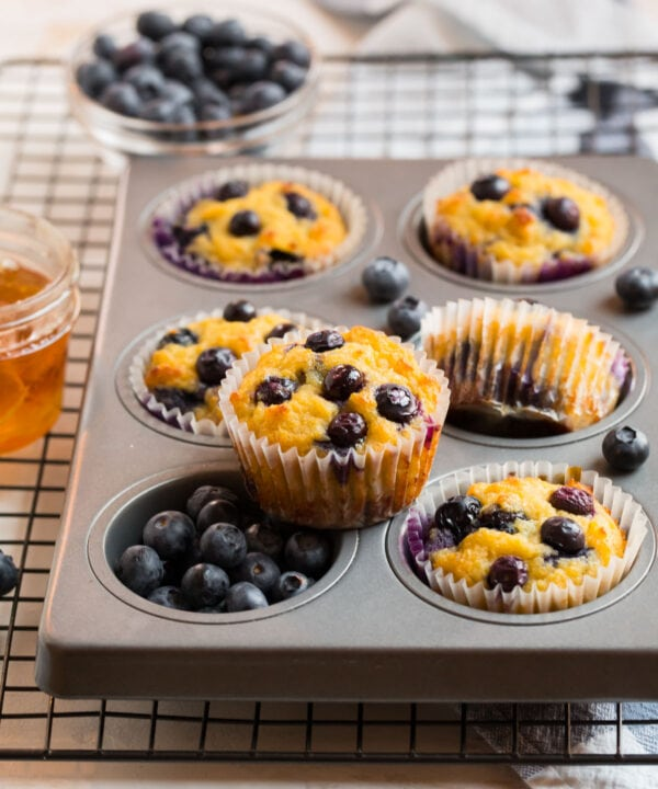 A pan filled with healthy blueberry coconut flour muffins