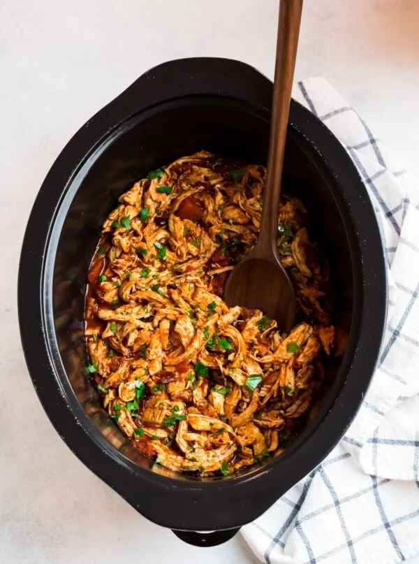 A slow cooker with shredded lean protein and tons of flavor