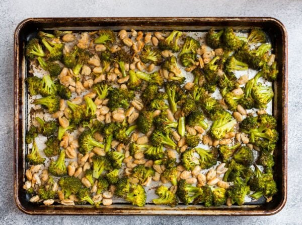 Roasted white beans and veggies on a baking sheet
