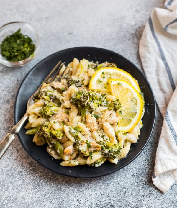 Easy cavatelli and broccoli recipe on a plate with lemon slices