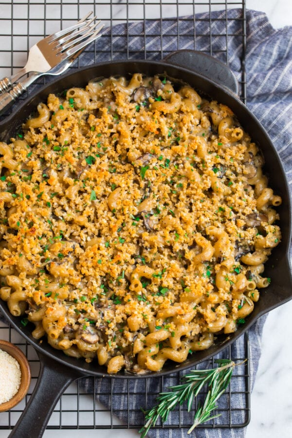 Baked mac and cheese with a breadcrumb topping and mushrooms