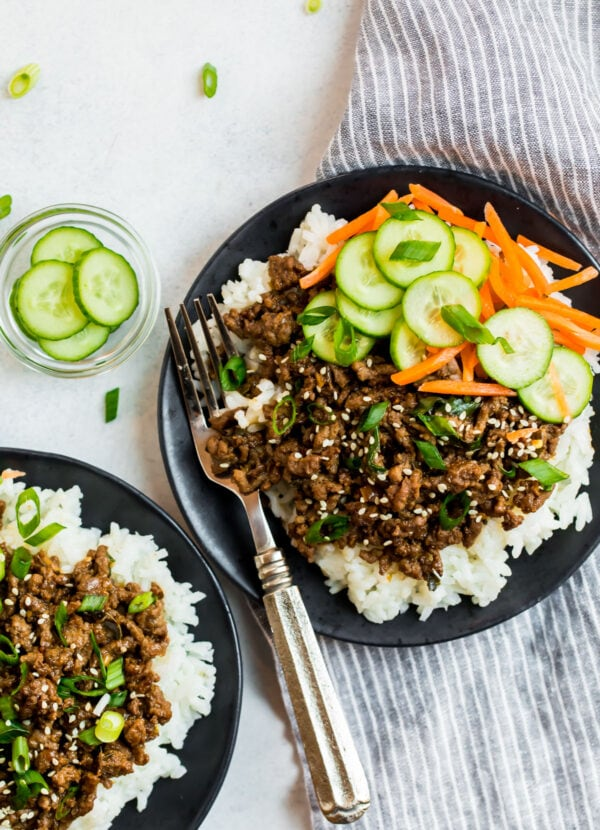 Two plates with the Korean beef bowl recipe for meal prep