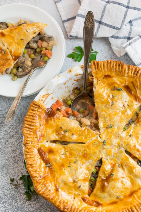 Golden and flaky healthy vegetable pot pie in a pie dish