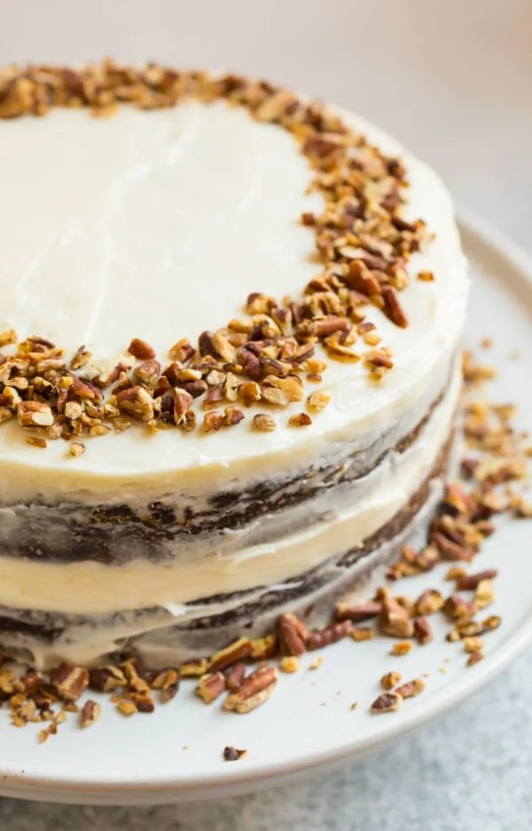 A beautifully decorated almond flour gluten free carrot cake topped with nuts