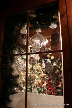 "Looking inside an Advent ""hutte."""