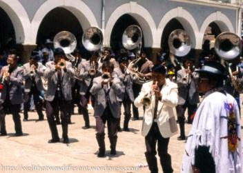 A village brass (tin) band shuffling along and playing pretty awful music