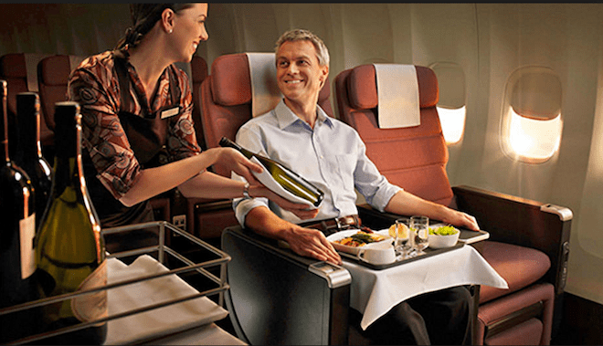 Qantas Premium Economy seating and meal service.