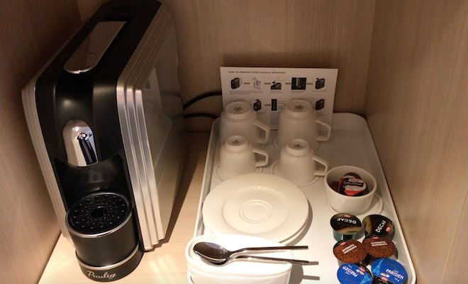 Coffee pod machine with Villeroy & Boch cups and saucers.