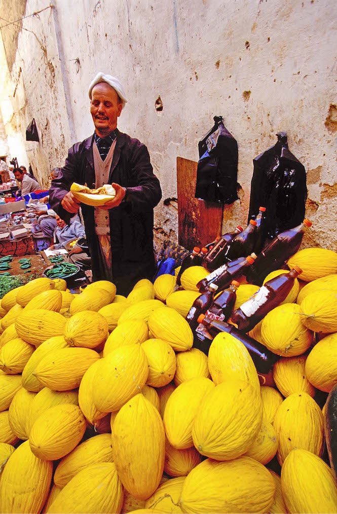 A wide angle lens forges a foreground _ background relationship like this melon seller in Fes, Morocco – Image credit Andrew Marshall.