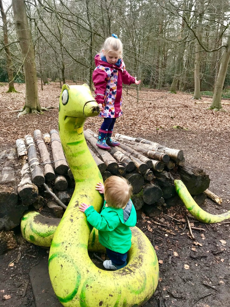 Slithering around with the snake in his log pile house