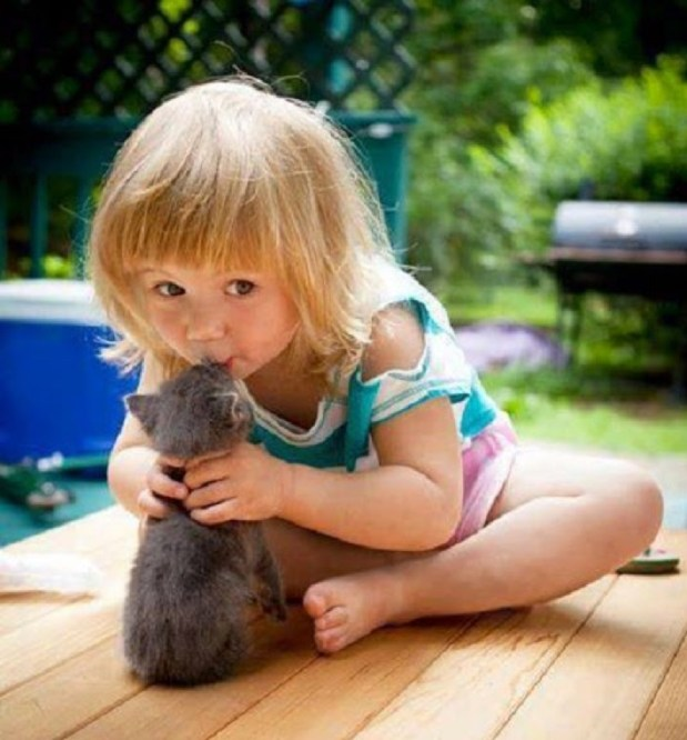 caption girl and cat