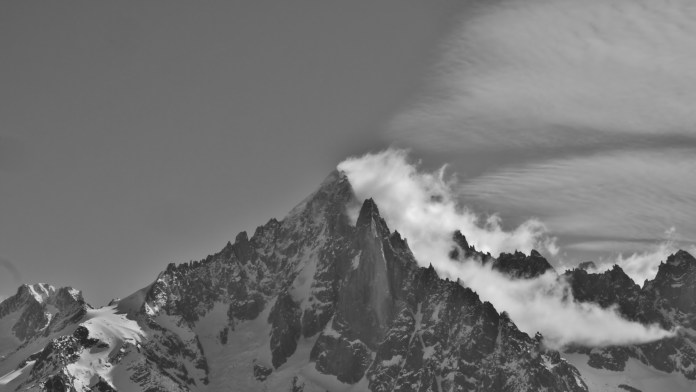Close up of the Drus with dramatic cloud flowing over it