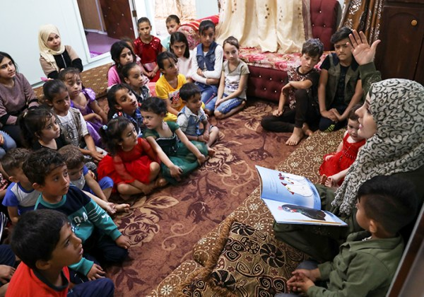 Syrian storyteller, Asmaa Al-Rashed, takes children in refugee camps into a world filled with hope through her stories