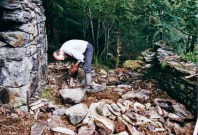 Paul Smyth begins reconstruction of a dry stone wall