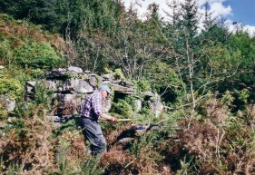 Harold Morris begins clearing the undergrowth at the Smithy