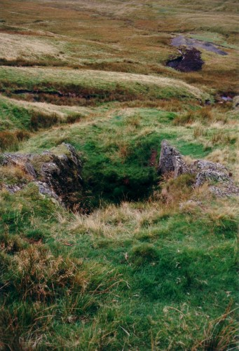 Looking west from above shaft, adit below, northeast of Nant Y Moch