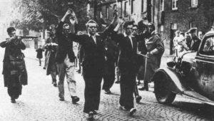 Belgische Widerstandskämpfer treiben deutsche Kollaborateure zusammen
