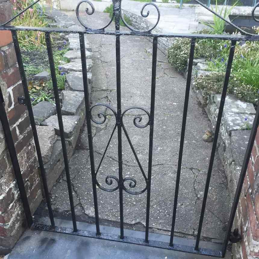 black painted metal gate