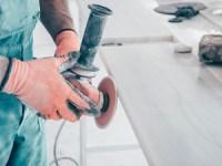 factory worker polishing granite