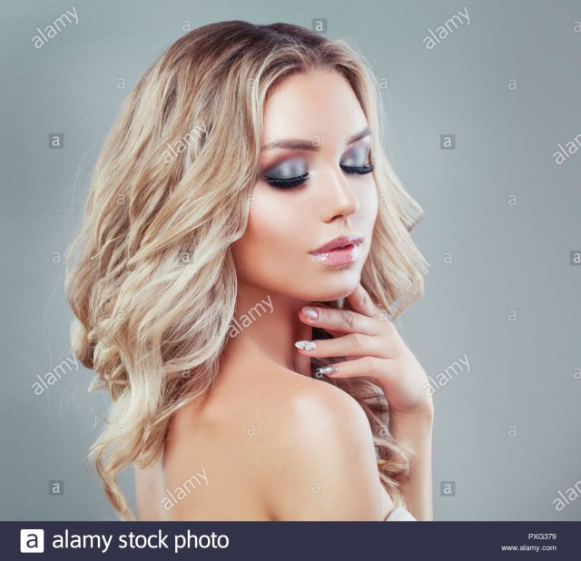 Makeup For Blue Eyes Blonde Hair Young Blonde Woman With Long Curly Hair And Makeup Eyes Closed