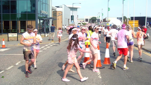 colour runners covered in vivid colours of paint