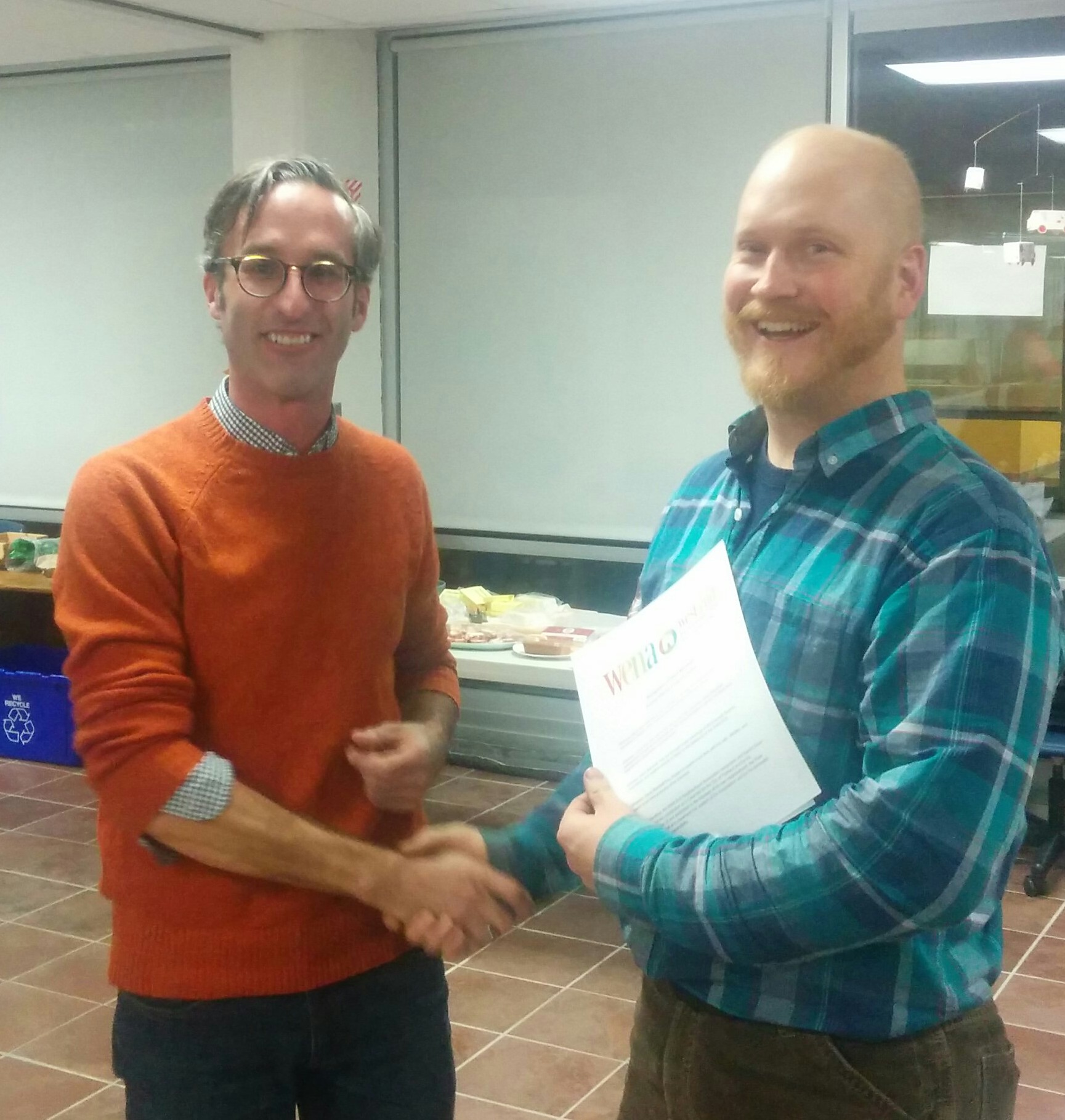 WENA President Ian Jacob handing Dave Marshall a letter of recognition for his service as District 2 City Councilor.
