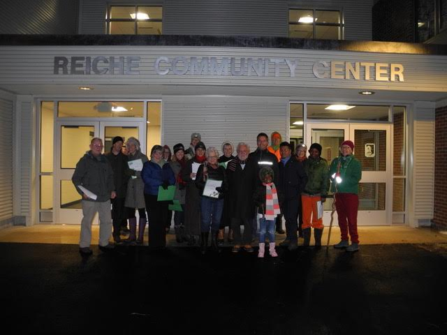 West End Carolers taking a group shot in front of the new entrance to the Reiche Community Center.