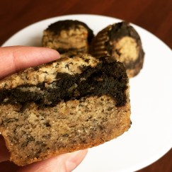 Half of a banana carob swirl muffin showing crumb and swirl