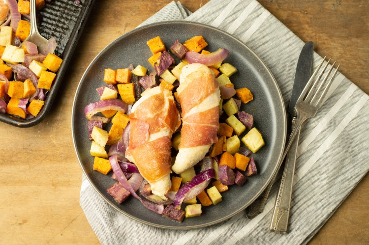 Variety of sweet potatoes, red onion, chicken and prosciutto, roasted.