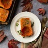 Glazed honeynut squash in a fall scene
