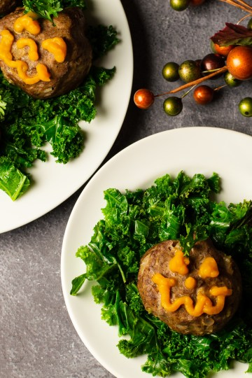 Halloween Mini Meatloaves - Jack-o-lantern shaped meatloaves with face piped on with pumpkin puree