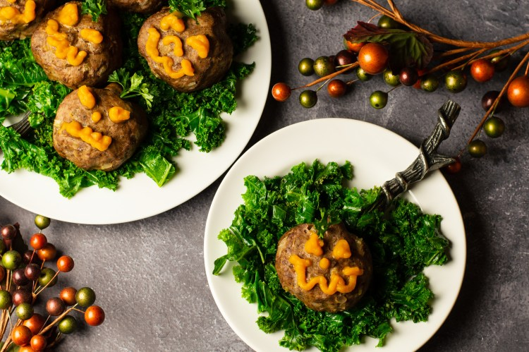Halloween Mini Meatloves -Jack-o-lantern shaped meatloaves with face piped on with pumpkin puree