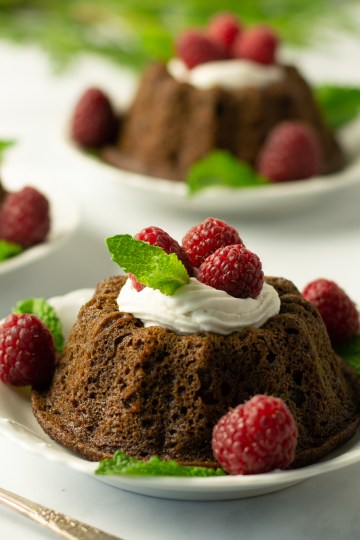 Gingerbread Mini Bundts garnished with lemon cream, raspberries and sprigs of mint