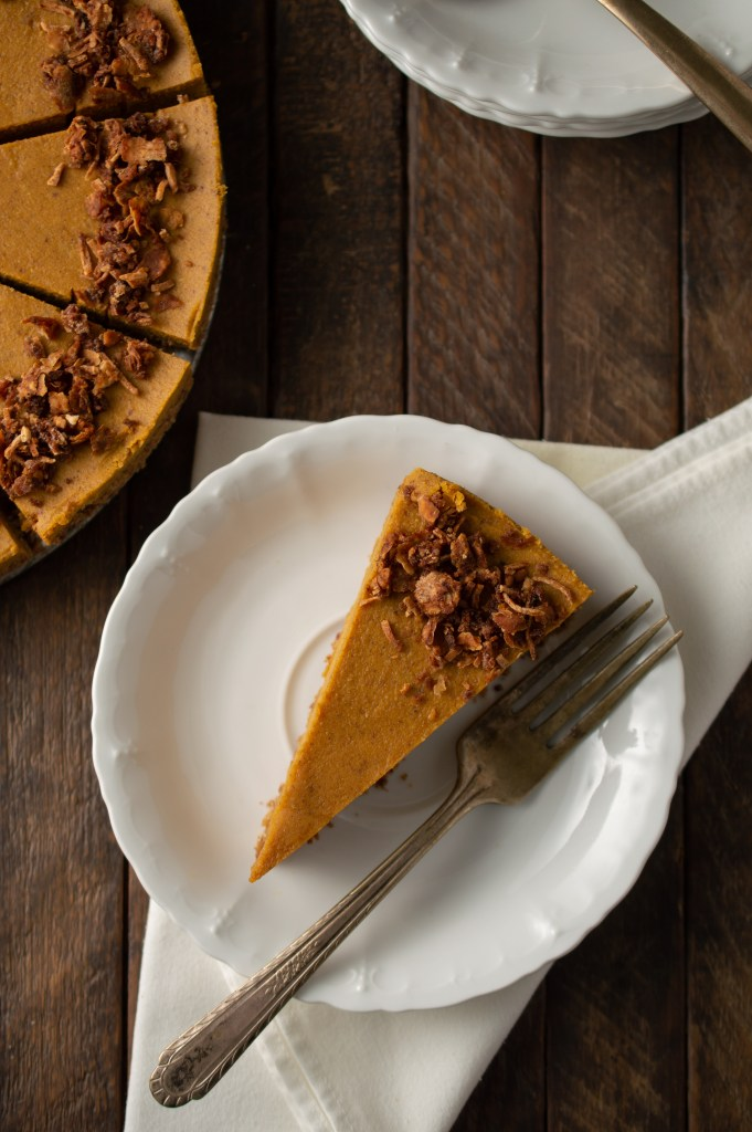 Overhead view of a slice of Pumpkin Spice Cheesecake (AIP/Paleo), garnished with pumpkin spice granola