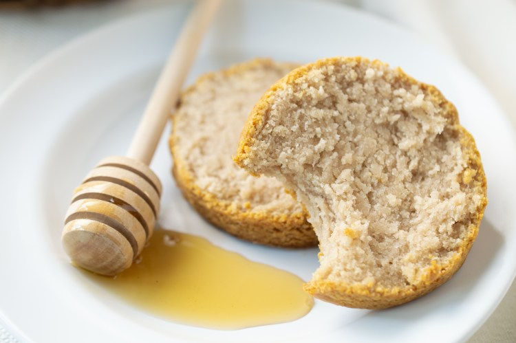 Closeup of Honey Biscuits (Paleo/AIP) next to a honey dipper