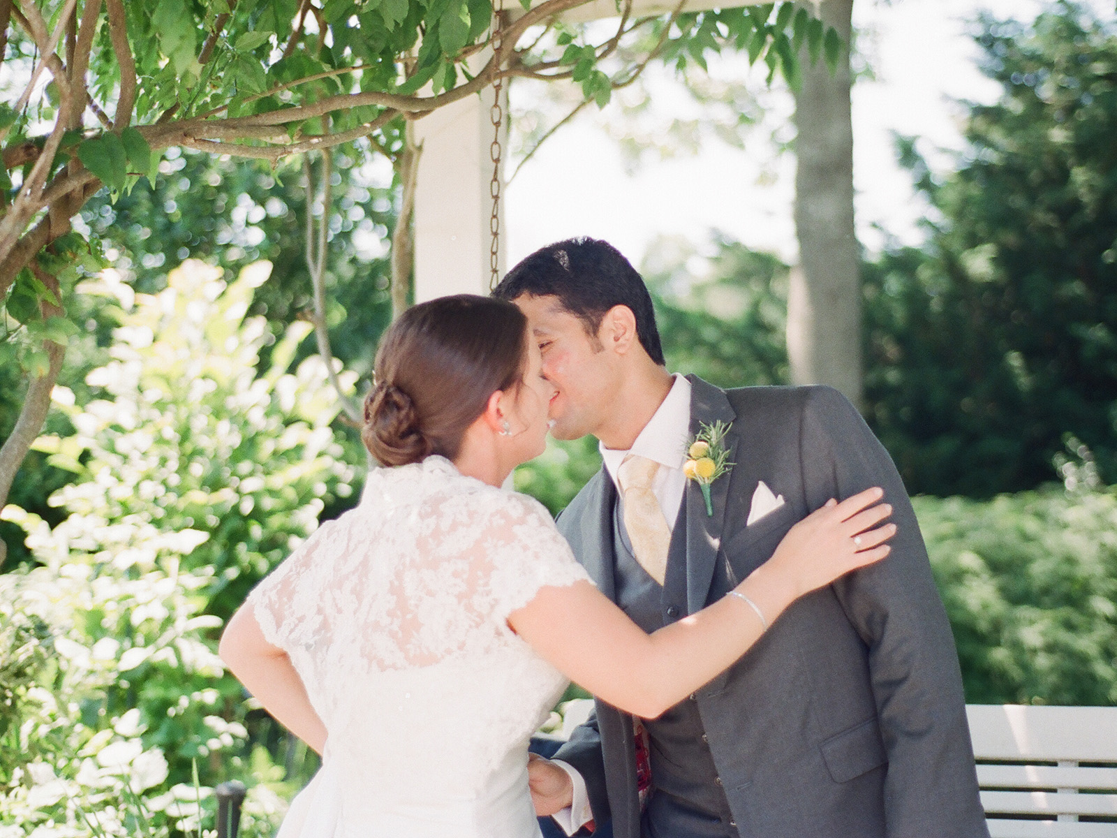 bride and groom kissing at first look