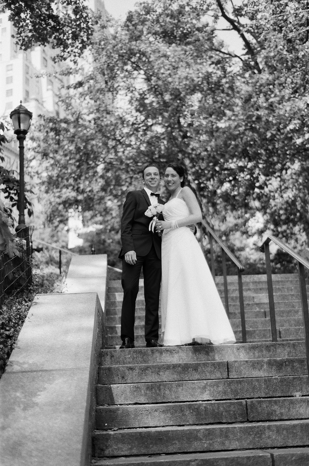 black and white film photograph of bride and groom in central park