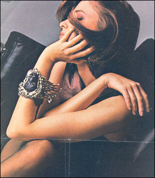 Model wears lion wristy cuff bracelet