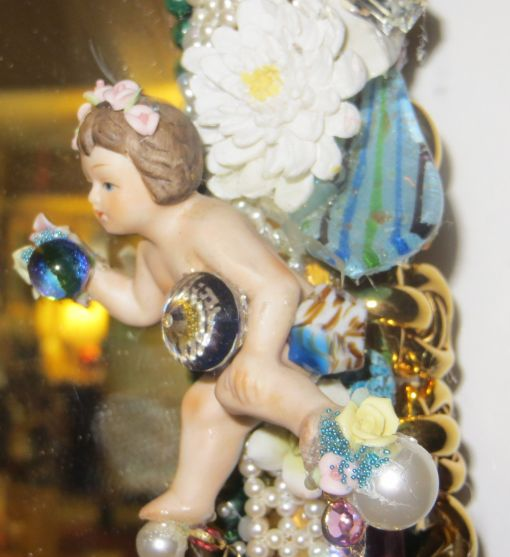 """3' 4"""" tall oval Magical Jeweled Mirror, insanely encrusted with cherubs, angels, jewels, pearls, and more by fashion jewelry designer Wendy Gell. Detail shot #7"""