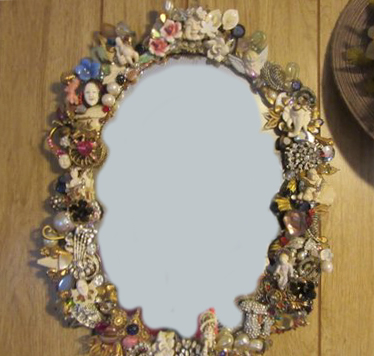 Vintage Netsuke Mirror, embellished by Wendy Gell and encrusted with vintage jewelry, netsukes, flowers and much, much, more!