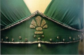 hand embroidered design is based on Tessa's necklace