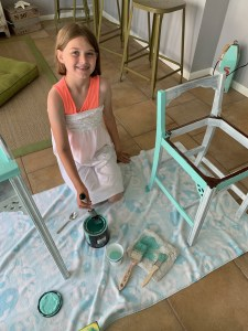 Niece painting a chair