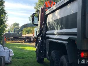 Unloading the digger prior to the rail trains arrival