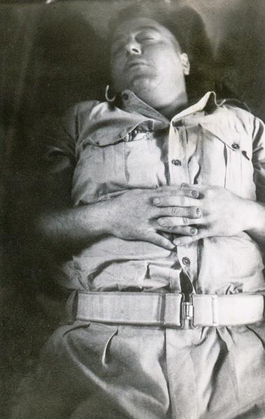 War Correspondent, photographer Jack Hickson, asleep on the tran