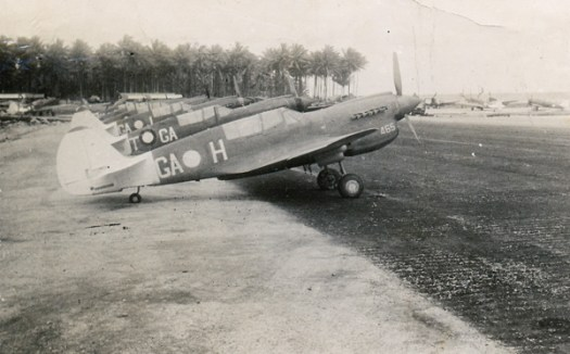 Kittyhawks of RAAF 75 Squadron lined up at Morotai airfield. Ide