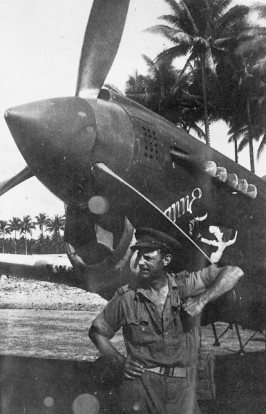 W.E. Pidgeon (WEP) posing with a P40 Kittyhawk possibly of RAAF