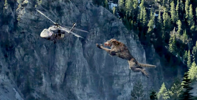 "Lack of werewolf in ""Rampage"" trailer chomps my heart, just like this giant wolf chomps a helicopter featured image"