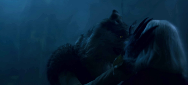 A werewolf strokes Sabrina's hair with a claw.