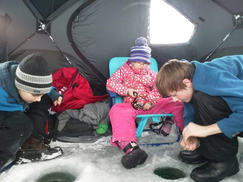 Kids ice in a heated ice shanty