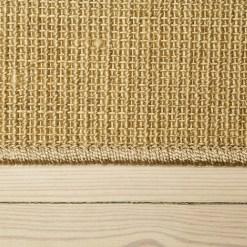 lysebrunt boucle sisal tæppe med kant